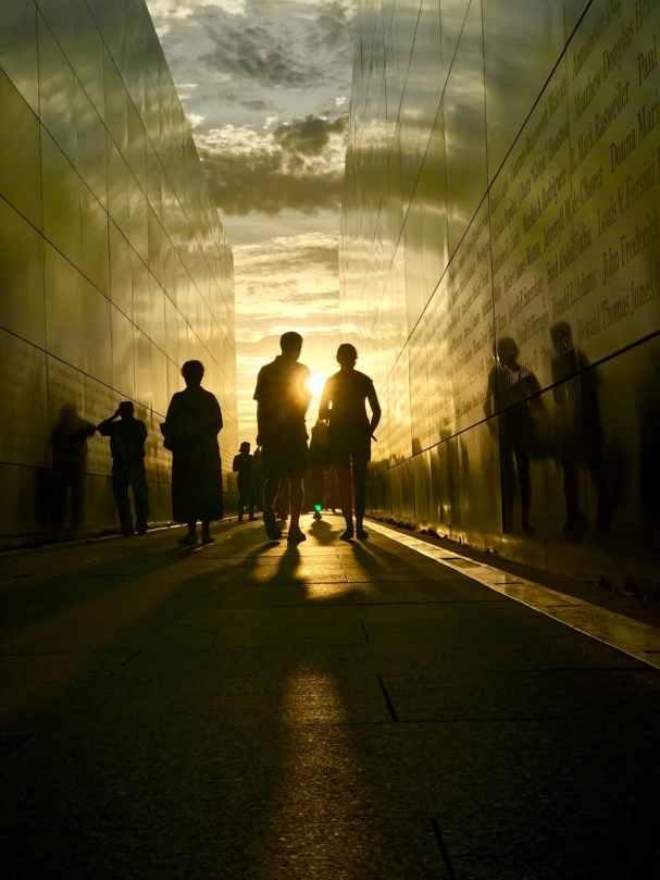 silhouette of people walking